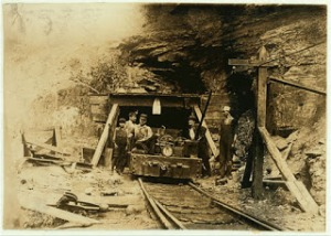 "Entrance to a W. Va. coal mine: a ""drift"" mine. The live-wire was only shoulder -high in places inside, and unprotected. Location: West Virginia. Sept. 1908 Lewis Hine Call Number: LOT 7477, no. 0132 [P&P]"